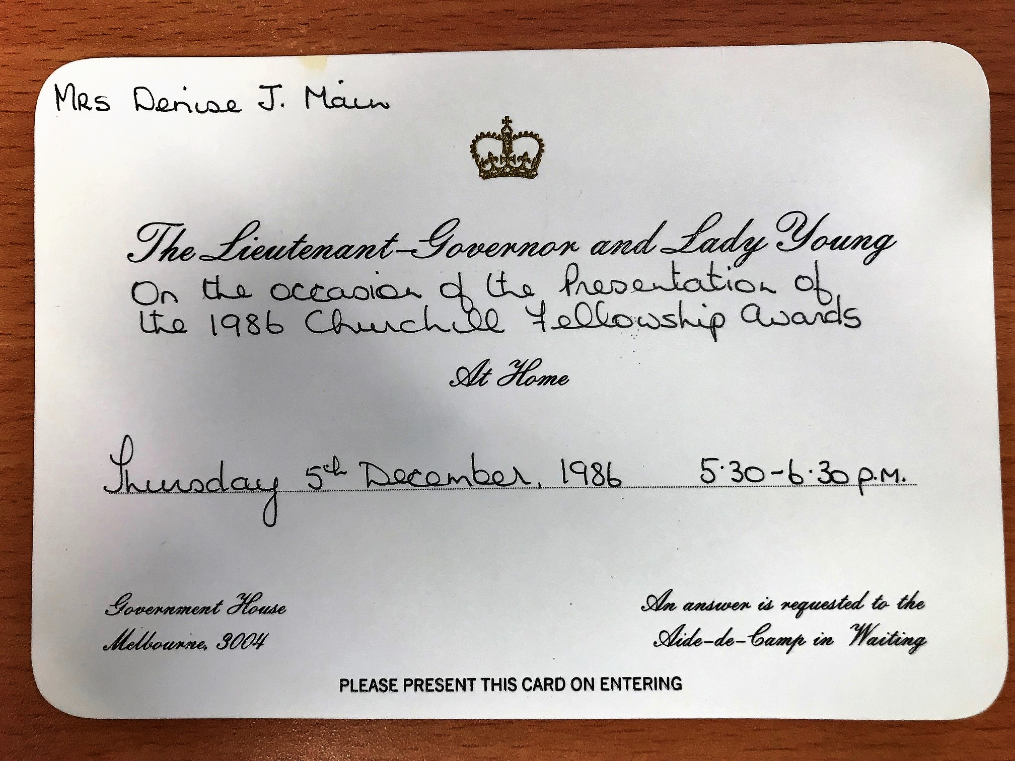 An official invitiation for Denis Main to receive the Churchill Fellowship from the Lieutenant Governor and Lady Young.